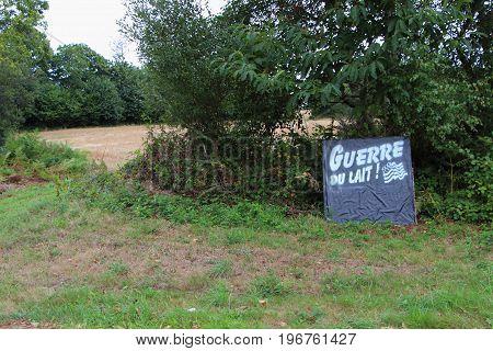 Milk war sign for farmer demonstration near a field