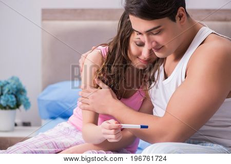 Young family with pregnancy test results