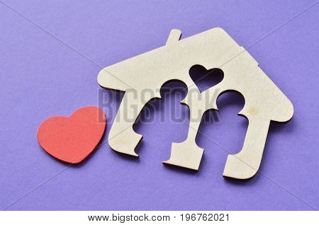 wooden house with red heart man and woman inside love and happy family concept