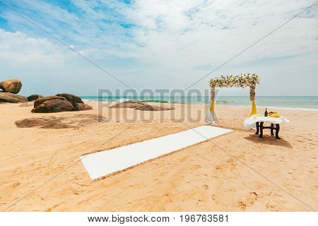 Romantic wedding ceremony on the beach. Decoration. Nobody