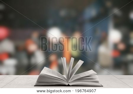open book on white table in a night club