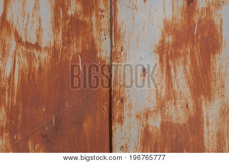 surface of rusty iron with remnants of old paint, texture background