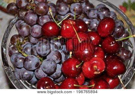Close-up of glass bowl full of delicious grapes and cherries, typical Christmas dinner fruits in Brazil. In São Manuel city, located in the São Paulo State, southwestern Brazil