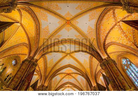 BUDAPEST, HUNGARY - FEBRUARY 23, 2016: Interior of Matthias Church is a Roman Catholic church located in Budapest, Hungary, in front of the Fisherman's Bastion at the heart of Buda's Castle District