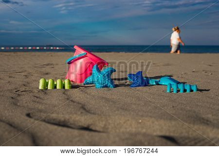 Children's Joys On A Sandy Beach, Scattered Toys For The Beach, A Can, A Blade, A Sea Star, In The B