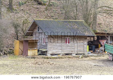 small rural log cabin at early spring time