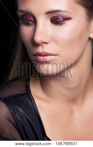 beauty portrait of blonde girl with wet eye shadow long hair studio shot