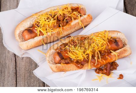 Grilled hot dogs with chlli and cheese