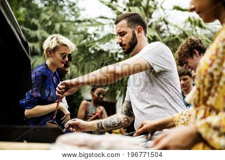 People cooking homemade food at backyard together