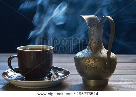 Closeup Cup Of Hot Coffee With Steam