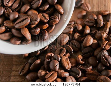 Close-up Of Half A Cup Of Coffee Beans