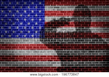 Military soldier saluting shadow on brick wall.