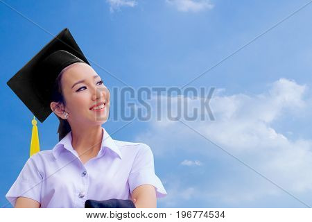 Women College Graduate Set Against The Blue Sky
