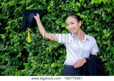 Graduation Hat In Hand, Happy Graduated Student Girl