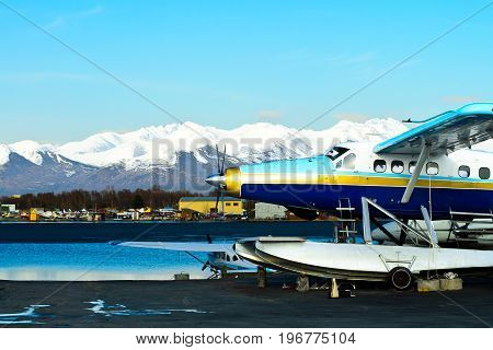An Alaskan float plane docked on Lake Hood