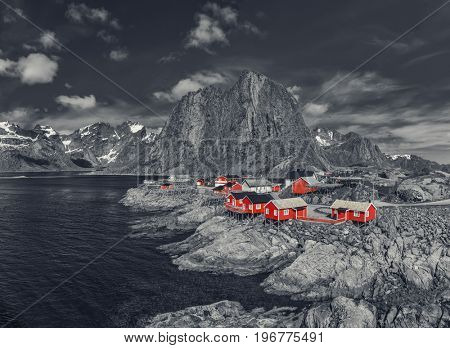 Reine On The Lofoten In Northern Norway. The Typical Norwegian Fishing Village Of Reine With The typical Rorbu House - Black and White Style