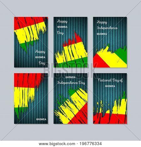 Guinea Patriotic Cards For National Day. Expressive Brush Stroke In National Flag Colors On Dark Str