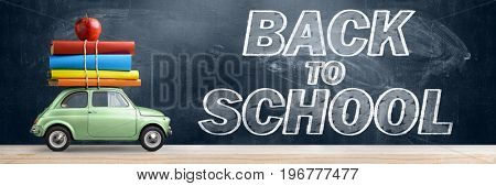 Back to school background. Car delivering books and apple against blackboard.