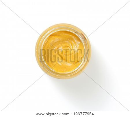 mustard sauce in plate isolated on white background