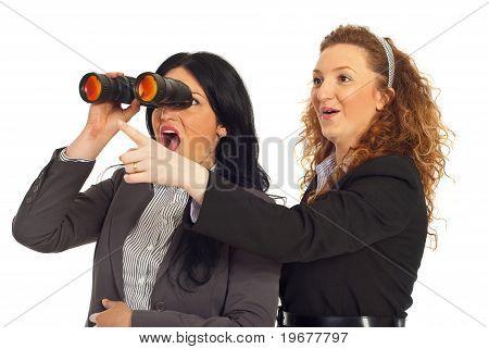Amazed Business Women Looking In Binocular