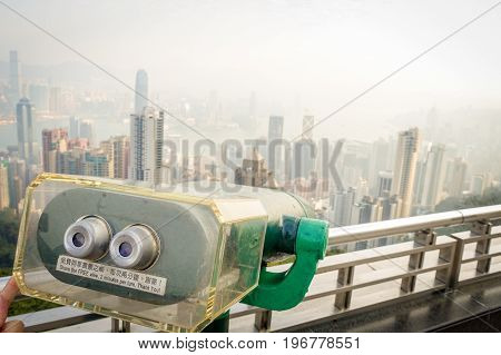 HONG KONG, CHINA - JANUARY 22, 2017: Close up of a view machine of victoria peak tower and tram in Hong Kong.