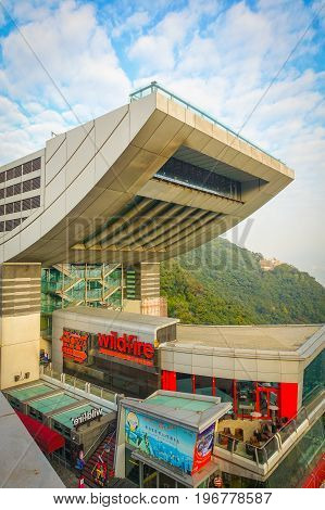HONG KONG, CHINA - JANUARY 22, 2017: View of the Peak Tower in Hong Kong a top Victoria Peak. At 428 meters above sea level, this iconic landmark features the highest viewing platform in Hong Kong.