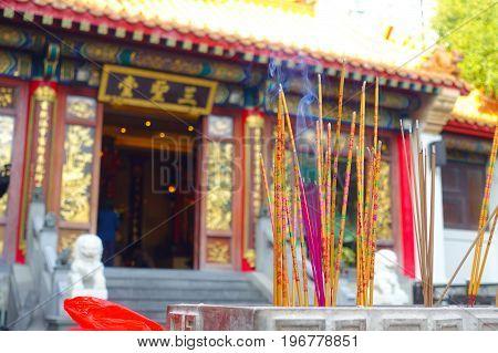 HONG KONG, CHINA - JANUARY 22, 2017: Close up of incenses burning up, inside of Wong Tai Sin Buddhist Temple to pray, in Hong Kong, China.