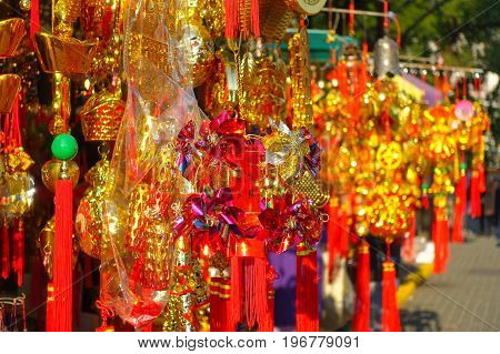 HONG KONG, CHINA - JANUARY 22, 2017: Colorful presents at the enter of Wong Tai Sin Buddhist Temple to pray, in Hong Kong, China.