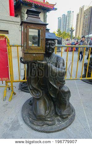 HONG KONG, CHINA - JANUARY 22, 2017: Stoned statue made of bronze at Wong Tai Sin temple enter in Hong Kong, China.