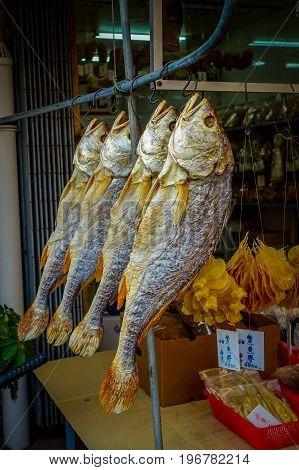 Fresh fish over a newspaper in a market in fishermen town in lantau, Hong Kong, China.