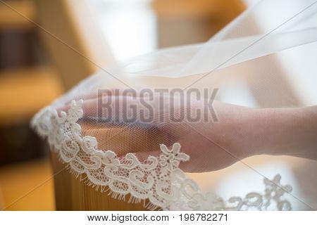 Bride's Hand On Wedding Under Veil