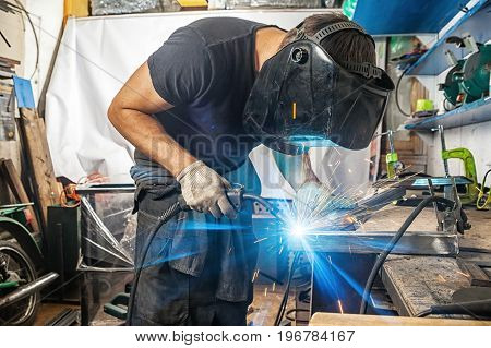Man Welds With A Welding Machine