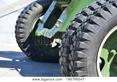 A Close-up Wheels Of A Portable Weapon Of The Soviet Union Of World War Ii, Painted In A Dark Green