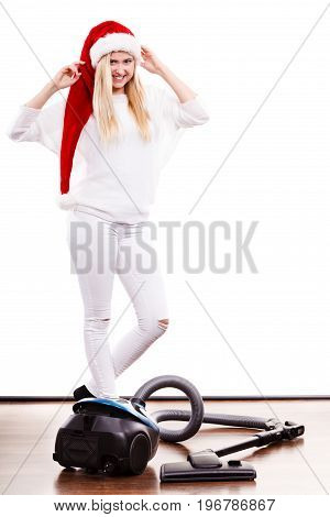 Girl In Santa Helper Hat With Vacuum Cleaner