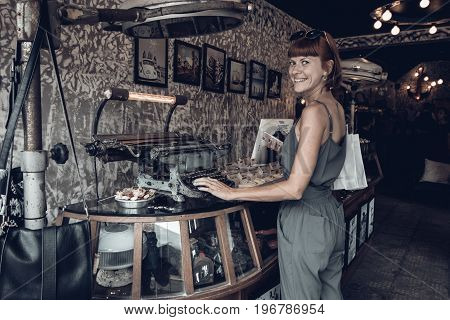 BALI, INDONESIA -JANUARY 1, 2017: Young woman in the souvenir shop, Ubud, Bali.