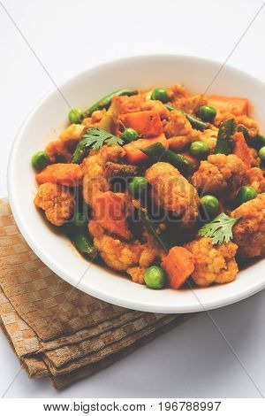 indian spicy food Gobi matar Masala or cauliflower curry with green peas or phool gobi fry, selective focus