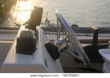 A dashboard of a speed boat at sunset