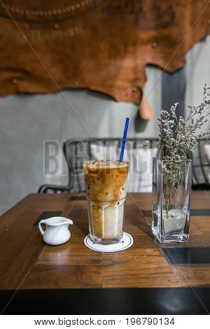Iced coffee latte on wooden table in coffeeshop