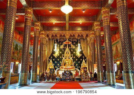 Loei, Thailand - July5, 2017: Golden buddha statue in main hall of  Wat Nimit Vipassana, temple at dan sai, Loei province, Thailand
