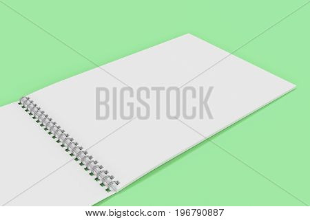 Open Blank White Notebook With Metal Spiral Bound On Green Background