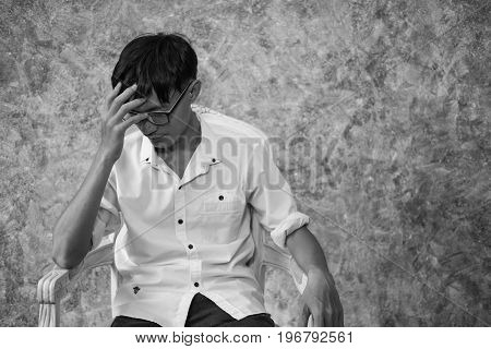 asian man sitting alone in the house concept of lonely sad alone person space alone and scared