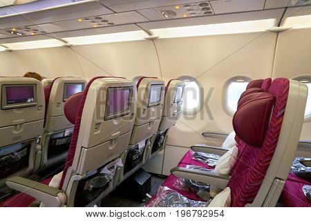 MOSCOW, RUSSIA - CIRCA MAY, 2017: inside Qatar Airways Airbus A321. Qatar Airways, is the state-owned flag carrier of Qatar.