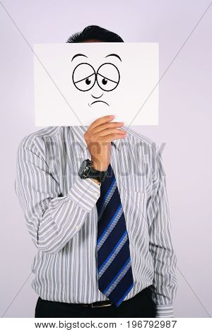 young Businessman Wearing sad Face Mask isolated on white