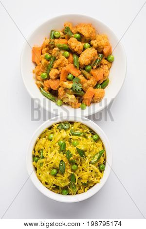 fried Patta Gobhi or Gobi with green peas sabji OR Cabbage sabzi with phool gobi or Cauliflower or flower sabji is the traditional Indian dish, selective focus