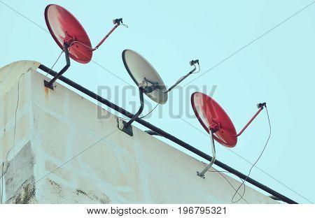 Dish satellite receiver with blue sky/ Vintage color filter