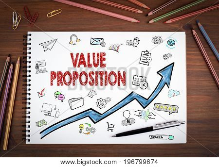 Value Proposition, Business Concept. Notebooks, pen and colored pencils on a wooden table.