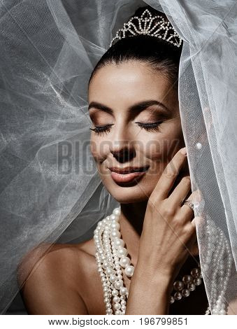 Beautiful young bride smiling eyes closed.