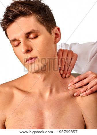 Shoulder and neck massage for man in spa salon. Doctor making therapy in rehabilitation center. Correction of dislocation of neck by experienced specialist. Skin rejuvenation.