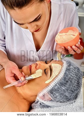 Collagen face mask . Facial skin treatment. Face of elderly elderly woman 50-60 years old receiving cosmetic procedure in beauty salon close up number one.