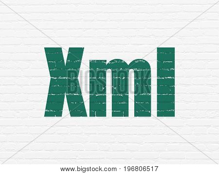 Software concept: Painted green text Xml on White Brick wall background